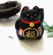 Mèo Maneki Neko bụng phệ xua đuổi tà ma